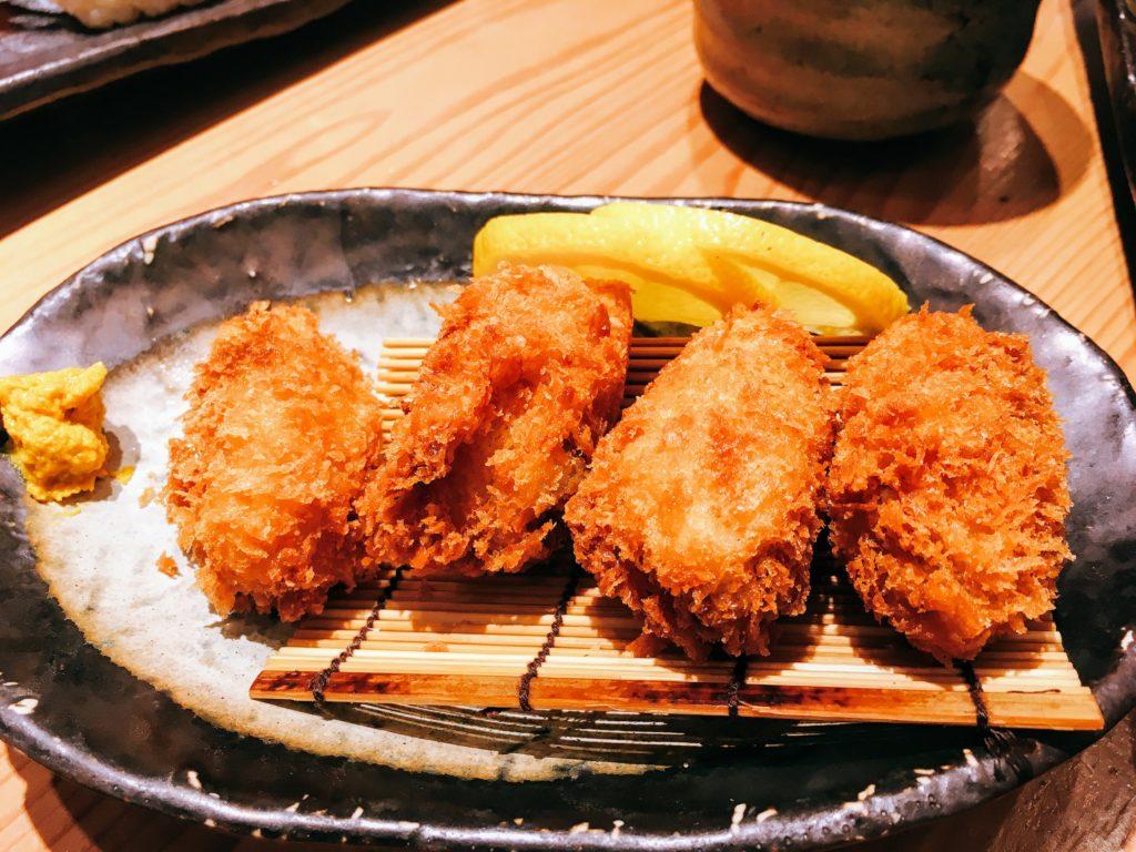 「意気な寿し処阿部 虎ノ門ヒルズ店」の牡蠣フライの写真